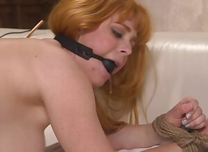 Cougar is gagged and gets banged in someone's skin doggy style position